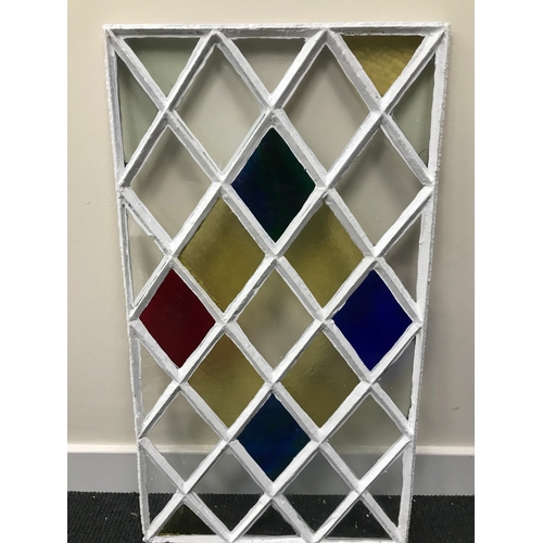 40C - A Georgian cast iron diamond shaped stainglass window panel. Measures 73x41cm (Original glass)...