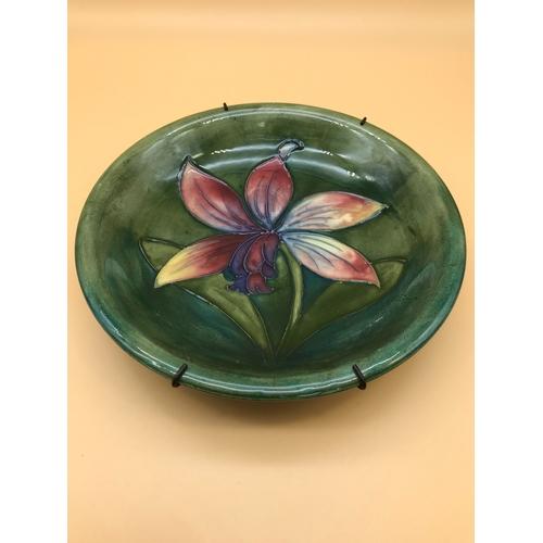 3 - A Signed William Moorcroft lily design bowl. Measures 19cm in diameter...