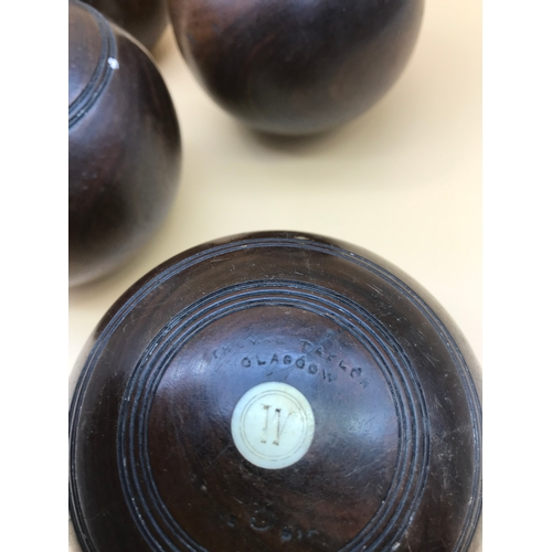 4 - A Set of 4 Victorian wooden bowls by Thomas Taylor Glasgow. Miniature bowls. Measure 8.5cm in height...