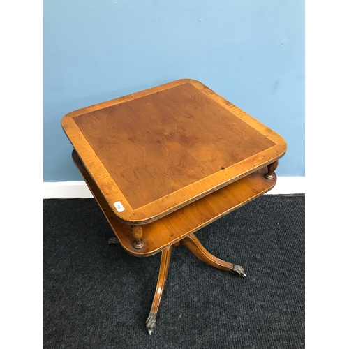 20A - A Reproduction yew wood pedestal side table. Styled with claw castor feet. Measures 57cm in height....