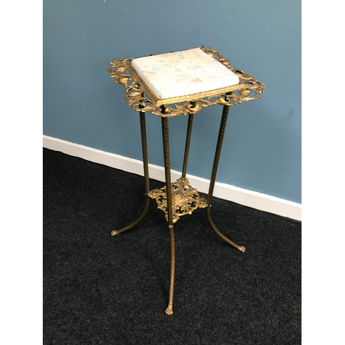 25A - Antique cast metal 2 tier plant stand, done in a regency style fitted with a marble top. Measures 76...