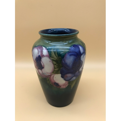 18 - Moorcroft Anemone design vase. Design includes large open, bulbous flowers and elongated foliage. Ci...