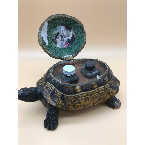 21 - Victorian taxidermy turtle made into an ink well stand. Fitted with a couple photograph to the insid...