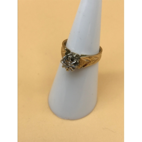 24 - A 9ct gold ladies ring styled with single diamond, size J. 3.44g in weight...