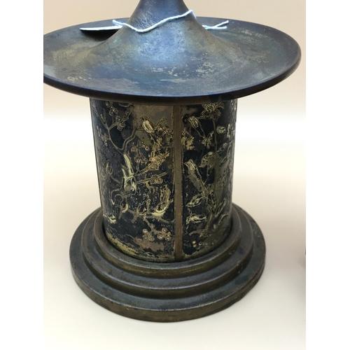 40 - An oriental detailed cigarette dispenser & pepper grinder....