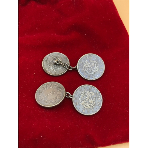 42 - A Pair of Japanese silver 10 Sen coin cuff links (4 coins in total)...
