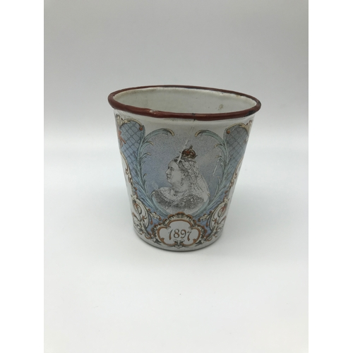 8 - A Victorian Royalty Queen Victoria enamel drinking cup. Measures 9cm in height....