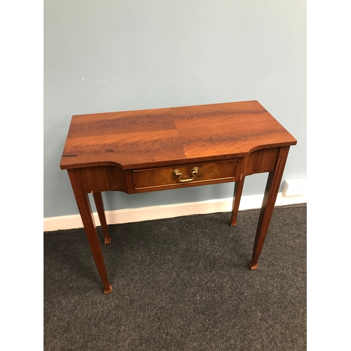 10A - A Reproduction one drawer console table. Measures 72x75x38cm...