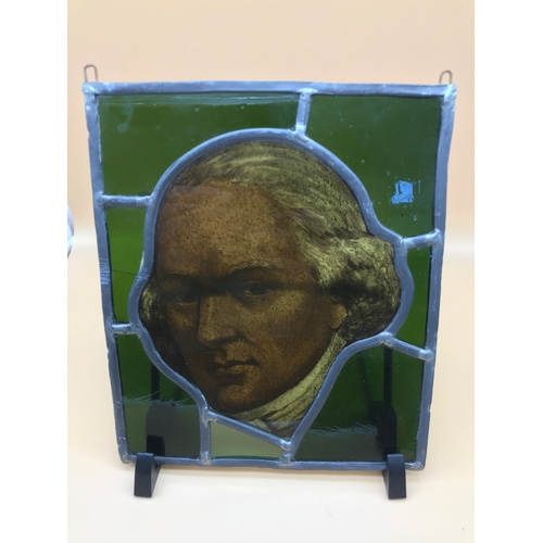1 - An antique stain glass window panel centred with a hand painted portrait of a gentleman. Measures 24...