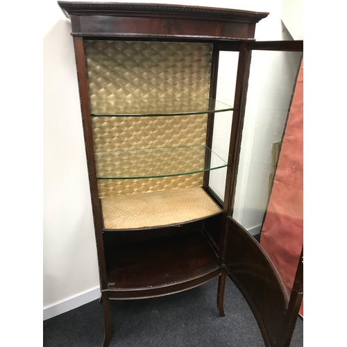 20B - Antique pedestal bow front display cabinet. Fitted with glass front door and glass shelves. Measures...