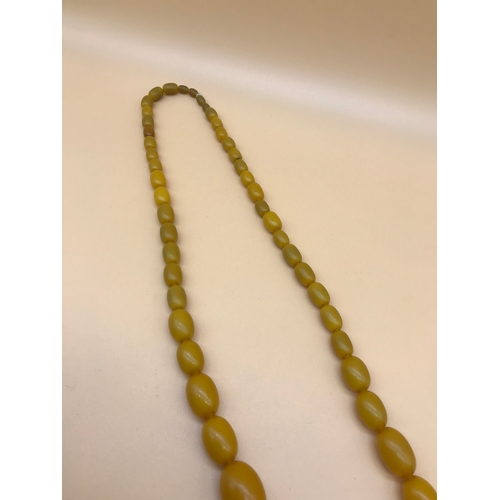 8 - A Vintage butterscotch amber graduating bead necklace....