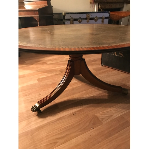 30B - A Large circular Leather topped library table. Measures 52cm in height & 106cm in diameter....