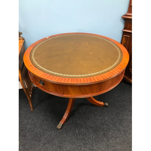 30C - A Reproduction large barrel top pedestal library table. Styled with leather to the top, two under dr...