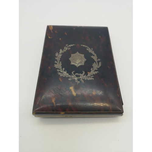33 - A Victorian tortoise shell card case, decorated with a silver design to the front (11x8cm)...