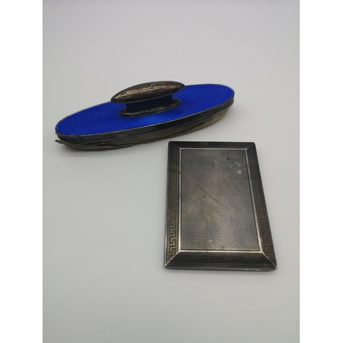 34 - A silver nail buffer designed with blue enamel (13cm), together with a Asprey London silver case dec...