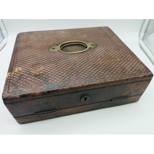 35 - A Victorian brown leather writing/stationary box (27x22.5cm)...