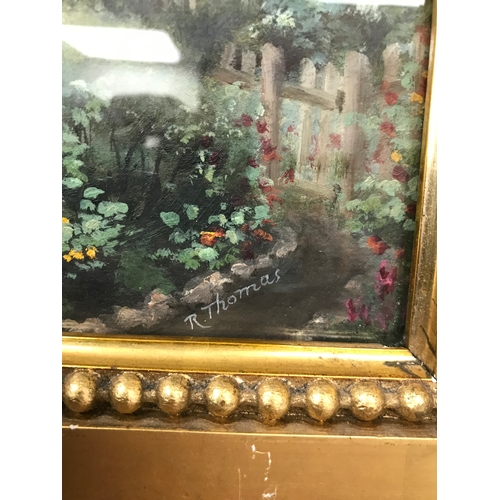 10 - An original oil painting depicting cottage and land. By R Thomas. Fitted within an antique gilt bobb...
