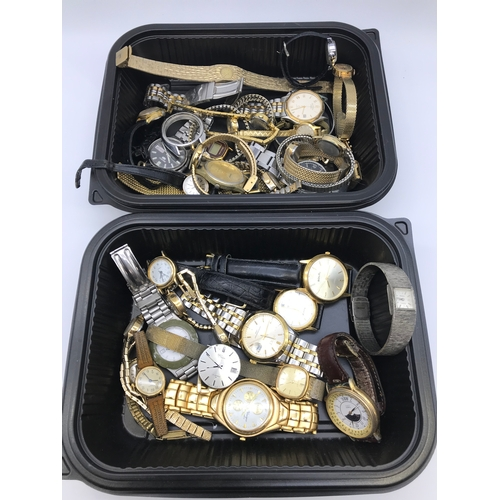 11 - 2 Tubs filled with various gents and ladies watches, includes makes such as Seiko, Timex & Sekonda....