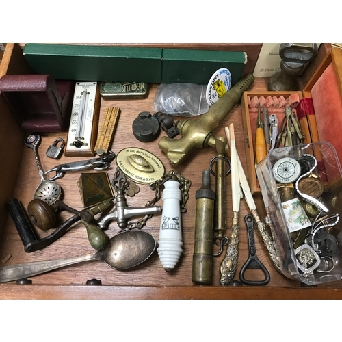 14 - A Drawer full of various collectables which includes Toilet pull, Clock winders, glove stretchers an...