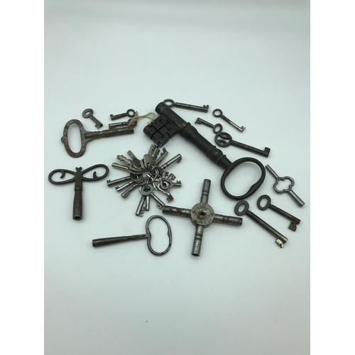 16 - A Collection of Victorian keys, Includes large Georgian key and various clock keys....