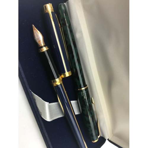 24 - A Parker Sonnet France pen together with a Elysee fountain pen fitted with 18ct gold nib...