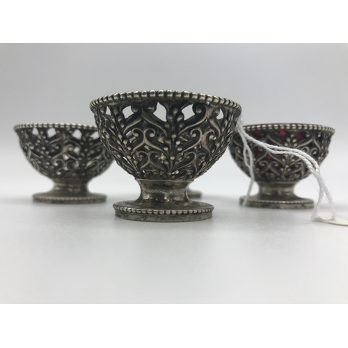 28 - Four Victorian silver salt dishes (two complete with cranberry glass inserts), by George Angell & Co...