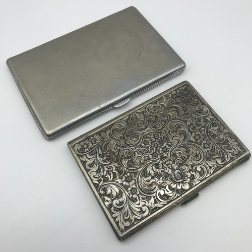 32 - A 800 grade silver ornate cigarette case (11x8cm) together with a white metal case (13cmx9cm)...