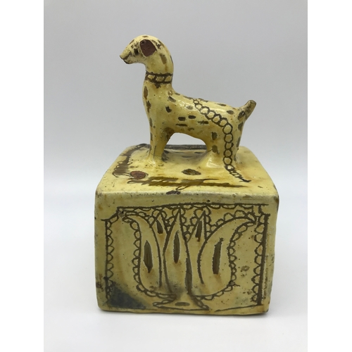86 - A 1793 Slipware Earthenware pottery bank, Modelled with a dog to the top. Engraved with the Name Mar...