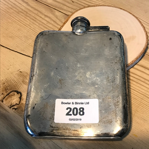 208 - A Sheffield silver hip flask (James Deacon & Sons, 1929). Measures 12.5x9cm...