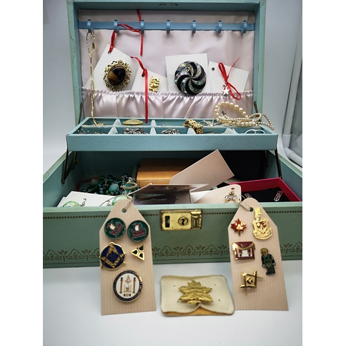 210 - A case filled with various costume jewellery, silver & Masonic pin badges etc...