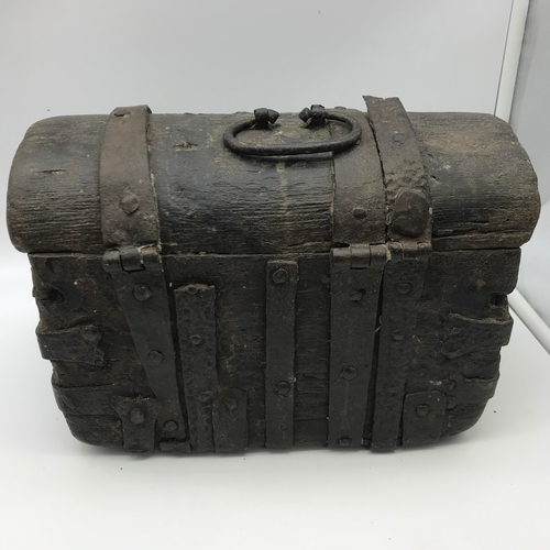 276 - A 15TH/ 16TH Century small treasure/ document trunk. Made from wood and cast iron hinges. Measures 2...