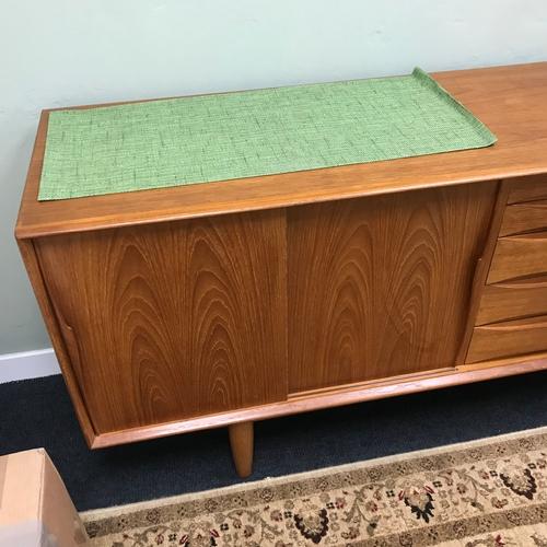 250C - A Large teak retro pedestal sidebaord, 4 sliding doors & 5 drawers. Measures 79x220x47cm...