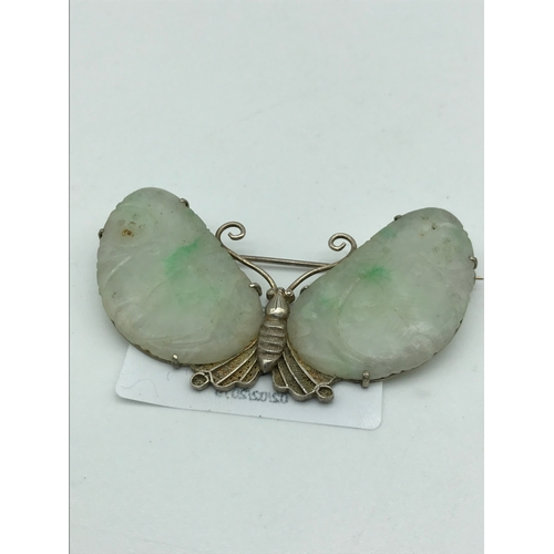 294 - An Oriental silver butterfly set with a pair of Mutton fat jade wings....