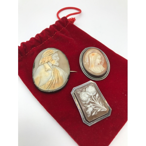 4 - A Lot of 3 Victorian cameo brooches set in silver frames. Floral design brooch is Edinburgh silver....