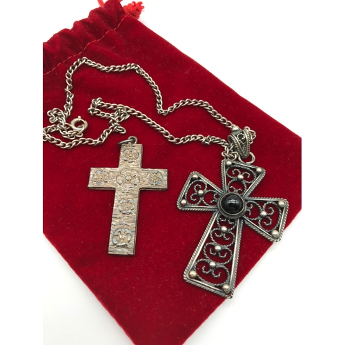 5 - A Filigree silver and black stone set cross pendant with silver chain together with London silver cr...