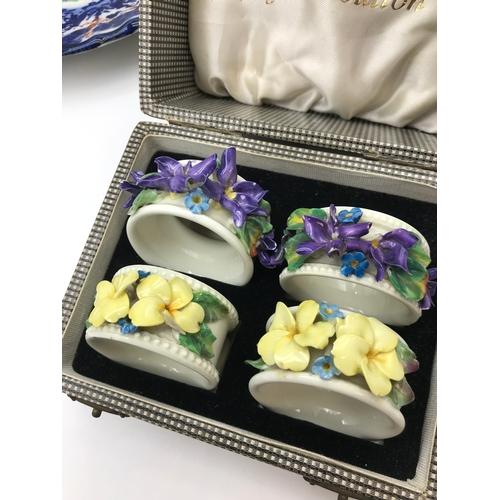27 - A Lot of 4 boxed Royal Doulton napkin rings....