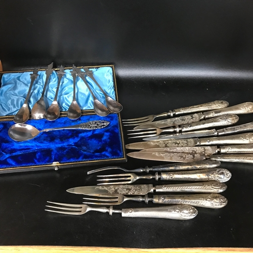 32 - A Lot of silver plated pickle knifes and forks, Oriental souvenir spoons and Danish boxed spoon....