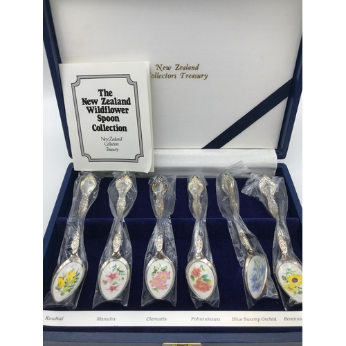 33 - A Boxed set of New Zealand wildflower spoon collection. Made with silver plate and Cloisonne....