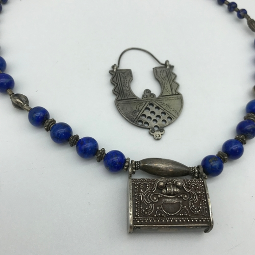 37 - A 925 Silver tribal pendant and blue hard stone necklace together with silver pendant....