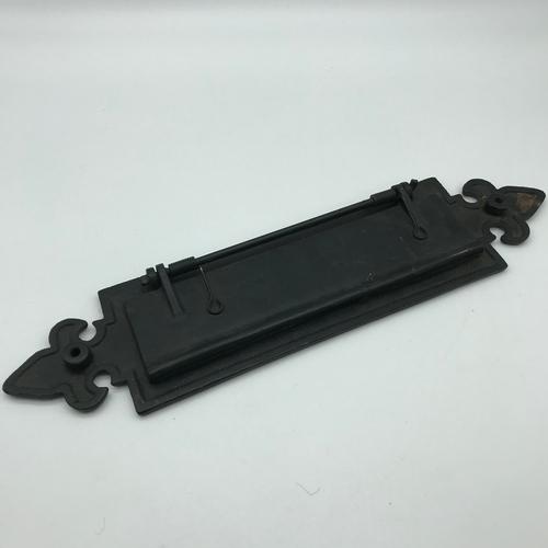 40 - A Cast iron letter box flap....