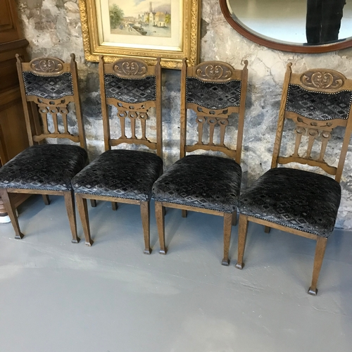 5A - A lot of four antique oak dining chairs in an arts & crafts manner...