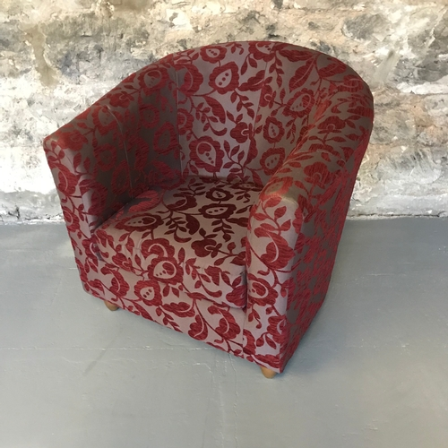 5B - A contemporary tub chair by Marks & Spencers, with a floral design upholstery...