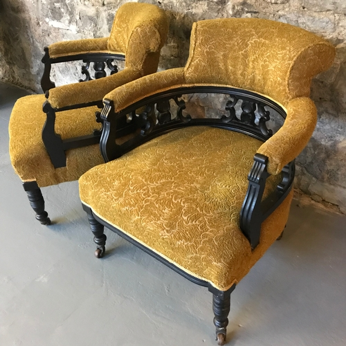 10A - A lot of two Victorian parlour tub chairs, upon turned legs and original castor feet, upholstered wi...