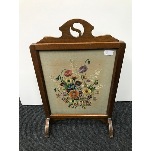 10B - A small arts & crafts fire screen fitted with a floral tapestry...