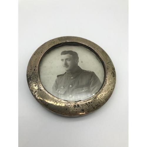 17 - A Birmingham silver circular frame. Maker Henry Clifford Davis. Dated 1911....