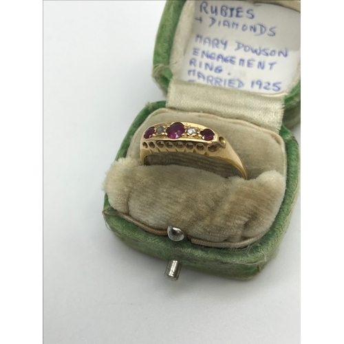 21 - An 18ct gold ladies ring set with 3 Ruby & 2 diamond stones. Originally belonged to Mary Dowson. eng...