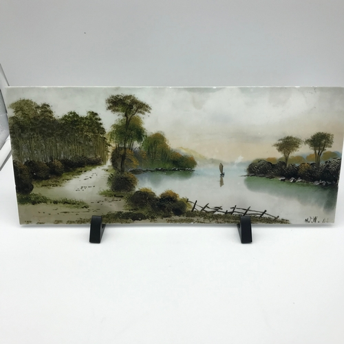20 - A Victorian painting on milk glass by M.J.W. DA. Measures 15x35.5cm...
