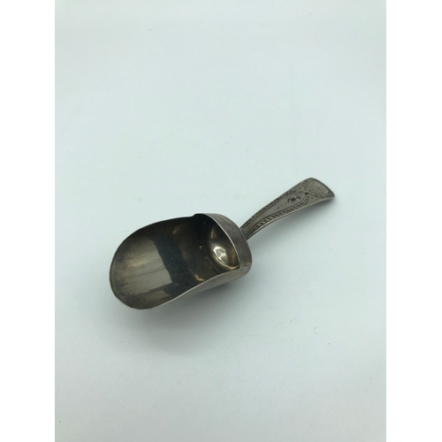 23 - A Georgian silver caddy spoon. Made by Josiah Snatt dated 1802. Measures 9.3cm in length...