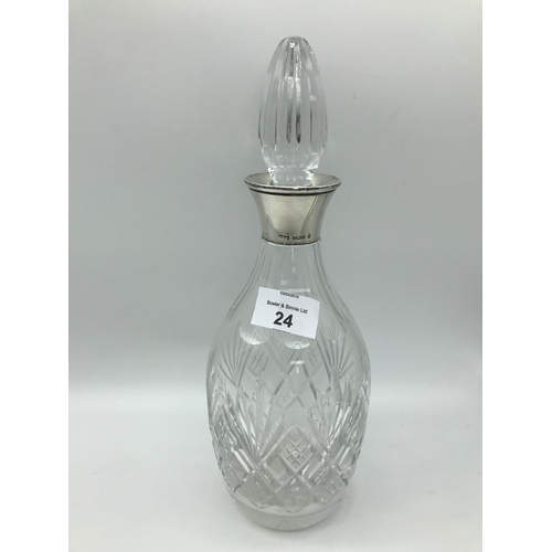 24 - A Birmingham silver collared crystal decanter by Maker Peter John Doherty. Dated 1977. Stands 28.3cm...