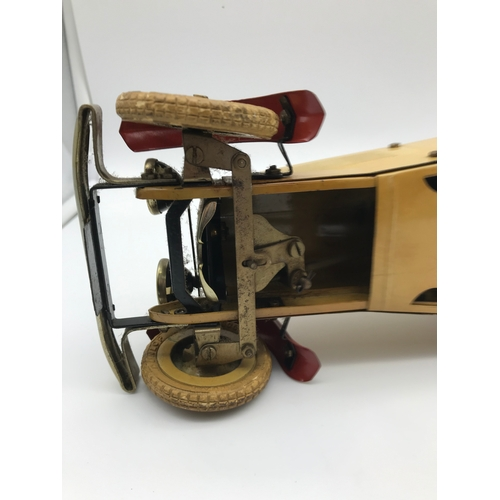 25 - A 1930's Meccano racing car construction set. Made from tin plate. Cream body with red trims and rac...